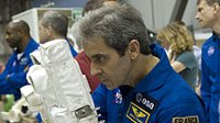 Eyharts using camera during Atlantis inspection