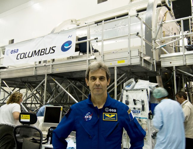 ESA astronaut Leopold Eyharts with the European Columbus laboratory in NASA's Space Station Processing Facility at KSC, Florida