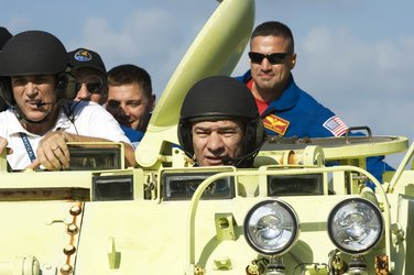 ESA astronaut Paolo Nespoli drives M-113 armoured personel carrier at KSC