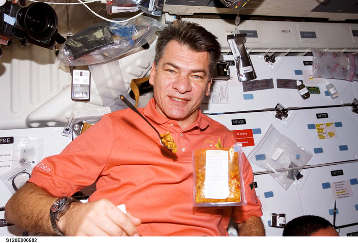 ESA astronaut Paolo Nespoli during a special Italian meal on board the Station