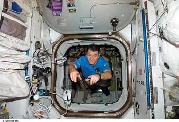 ESA astronaut Paolo Nespoli enters the International Space Station