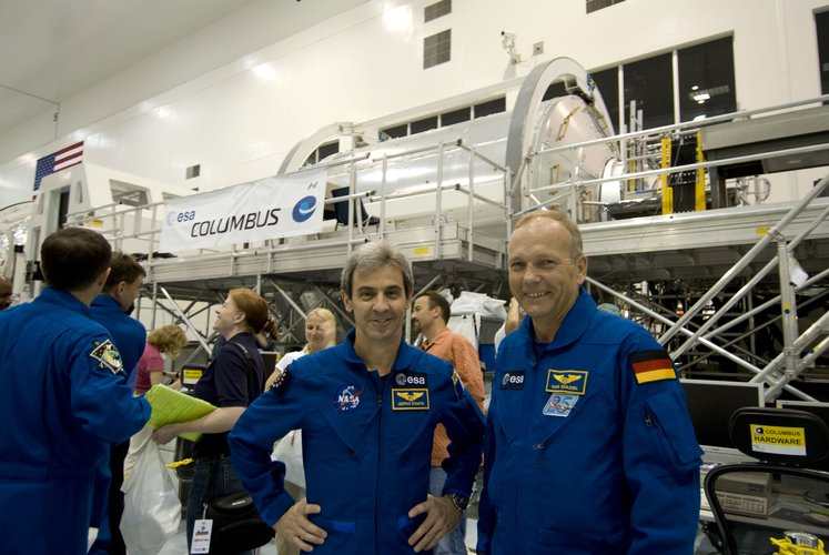 ESA astronauts Leopold Eyharts and Hans Schlegel with the European Columbus laboratory in the SSPF at KSC, Florida