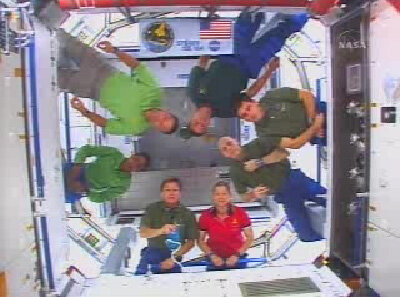 Members of the Shuttle and ISS crews participate in a join press event - the first to be hosted inside Harmony