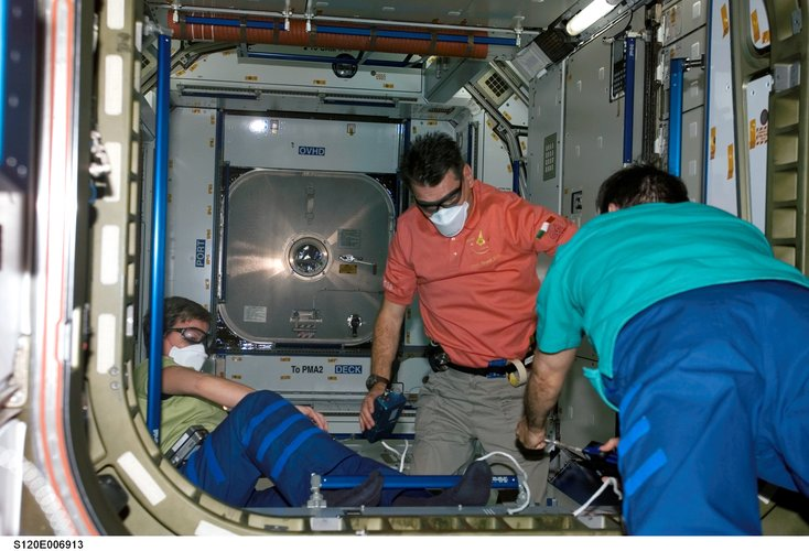 Nespoli and Whitson wore protective goggles and face masks to protect themselves in case of any loose flying objects inside