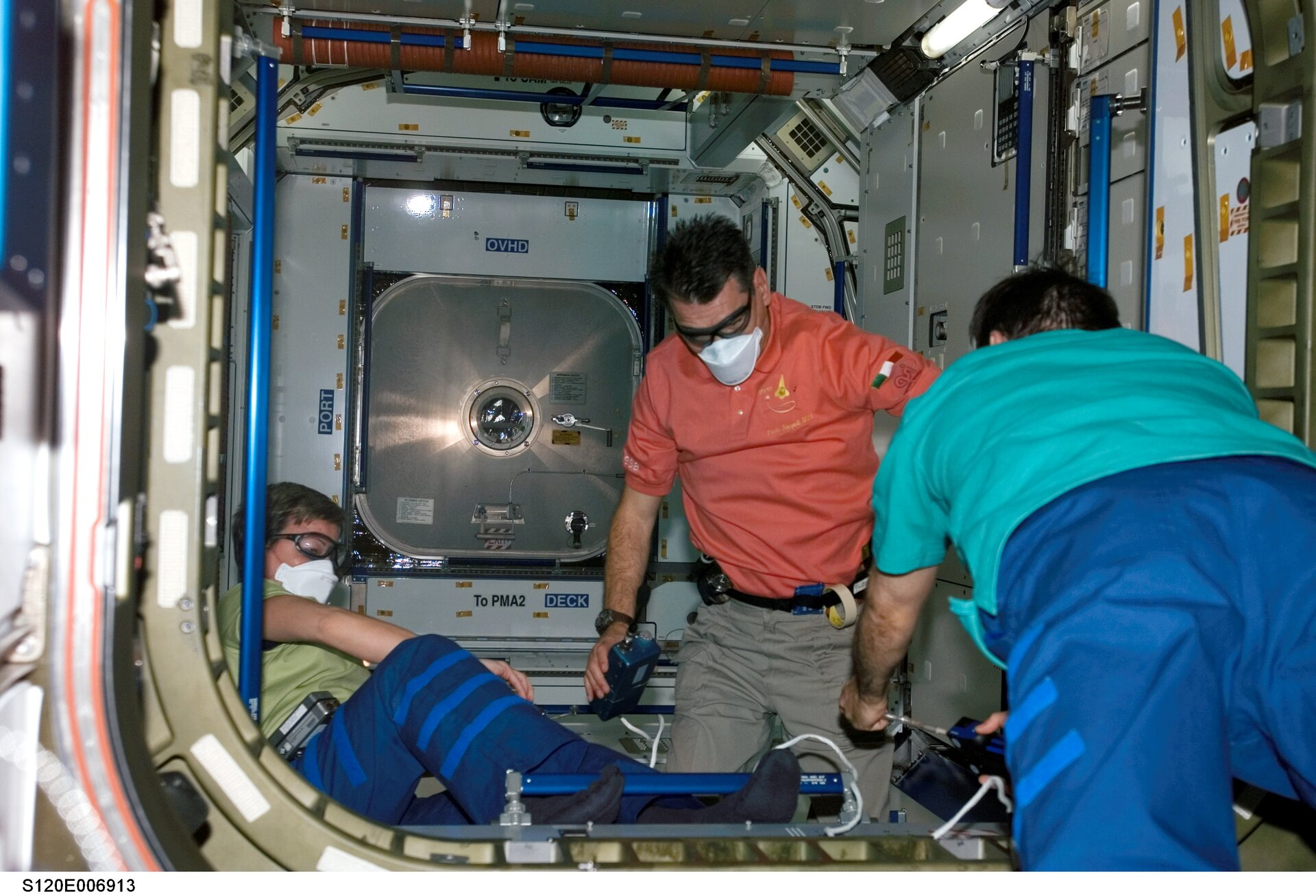 Nespoli and Whitson wore protective goggles and face masks to protect themselves in case of any loose flying objects inside the new module