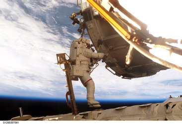 Outfitting Harmony during the STS-120 mission's second spacewalk