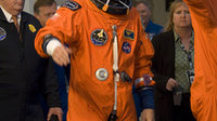 STS-120 mission crew walk out