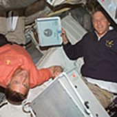 Parazynski and Wheelock prepare for spacewalk