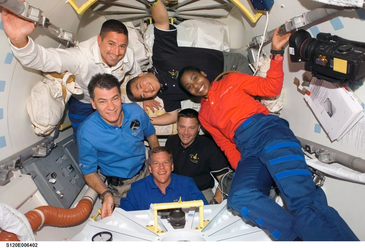 STS-120 crew members after hatch opening between ISS and Discovery