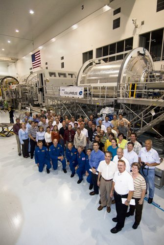 STS-122 astronauts and support team with the European Columbus laboratory