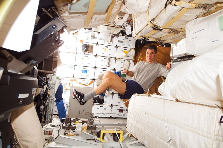 ESA astronaut Paolo Nespoli exercising during the STS-120 mission