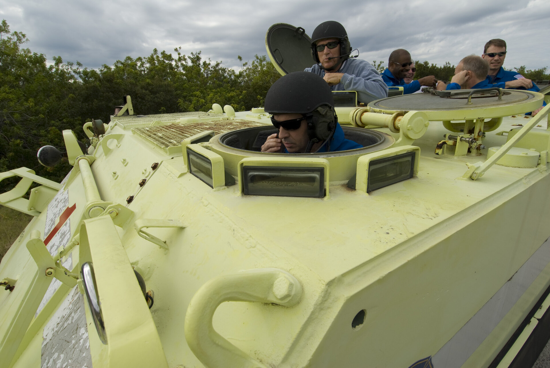 Léopold Eyharts practices driving an emergency evacuation vehicle during training at Kennedy Space Center, Florida