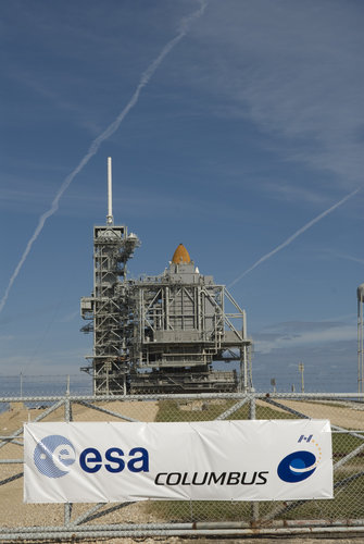 NASA's Space Shuttle Atlantis stands on the launch pad ready to carry the European Columbus laboratory to the ISS