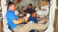 Preparing for fourth spacewalk in the Quest Airlock