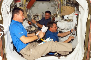Nespoli, Parazynski and Wheelock prepare for the mission's fourth spacewalk