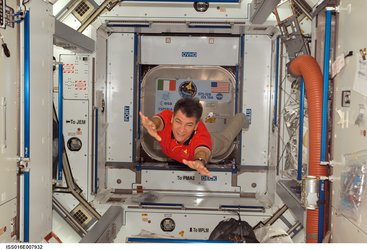 Paolo Nespoli floats in the Harmony node of the International Space Station