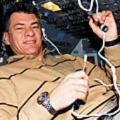 Paolo Nespoli uses communication system on the Shuttle flight de
