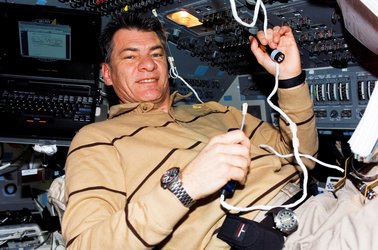 Paolo Nespoli uses communication system on the Shuttle flight deck