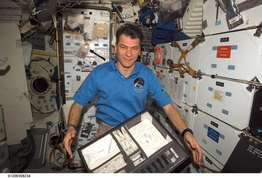 Paolo Nespoli with Spore experiment hardware