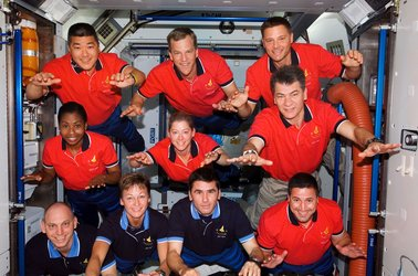 STS-120 and Expedition 16 crewmembers pose for a group photo inside Harmony