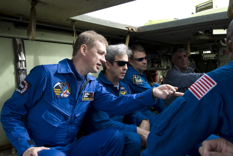 STS-122 crew inside an emergency evacuation vehicle at Kennedy Space Center
