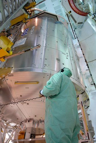 The European Columbus laboratory is transferred into Space Shuttle Atlantis' payload bay