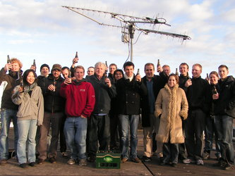 The GENSO team celebrates the successful demonstration next to the rotating antennas.