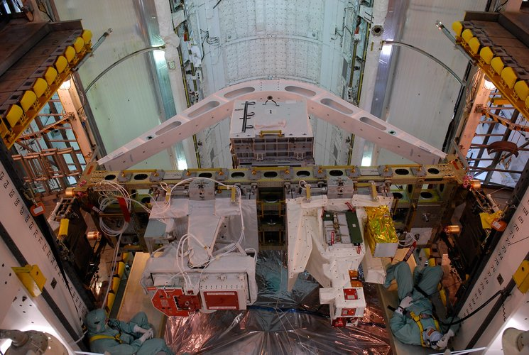 The integrated cargo carrier-lite is transferred to Space Shuttle Atlantis' payload bay