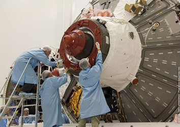 Engineers work on Jules Verne ATV's docking mechanism