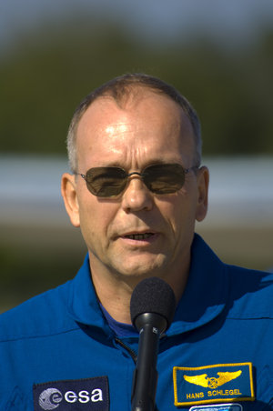 Hans Schlegel gives a brief speech after arriving at NASA's Kennedy Space Center ahead of the STS-122 mission