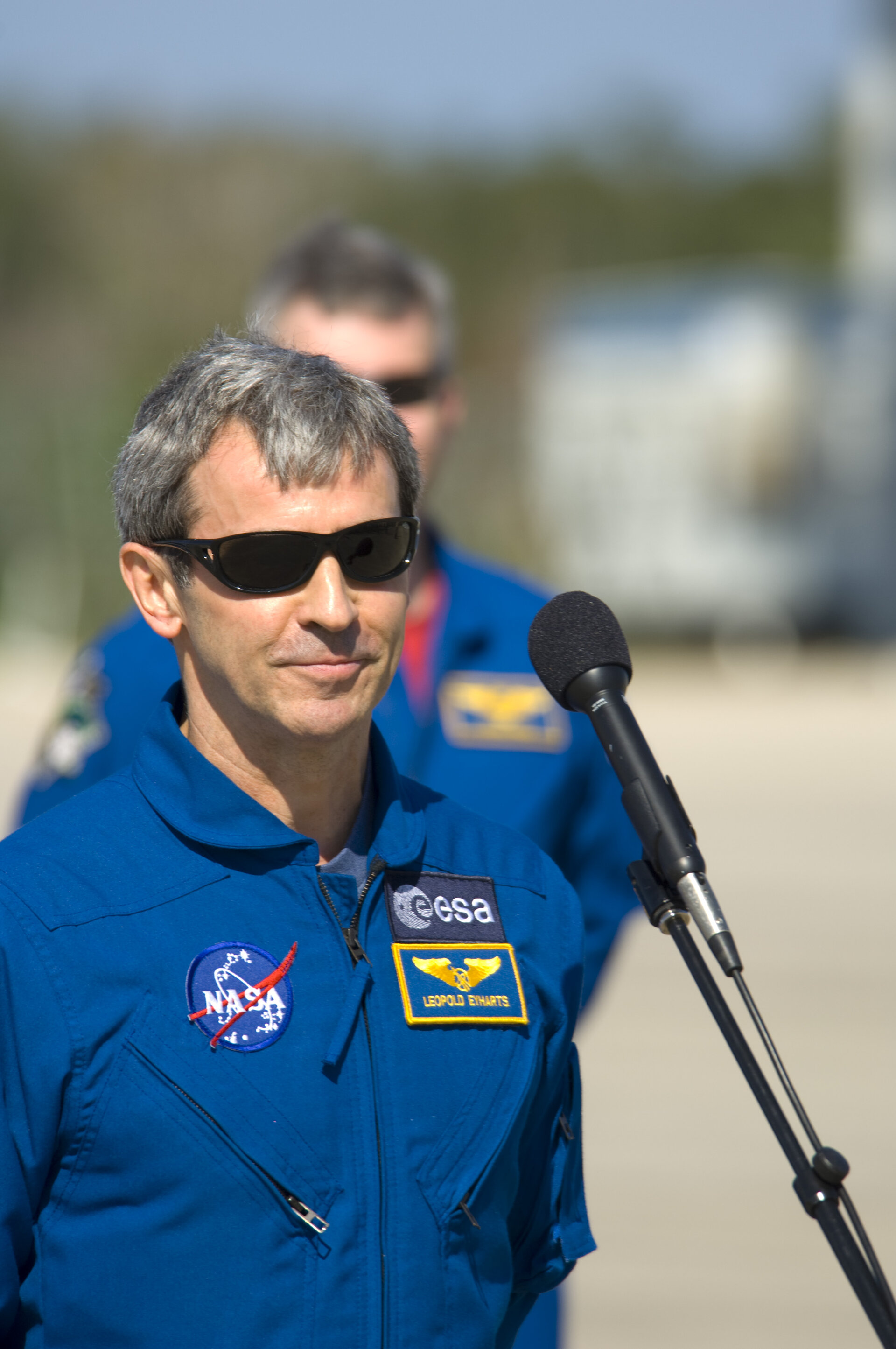 Leopold Eyharts gives a brief speech after arriving at NASA's Kennedy Space Center ahead of the STS-122 mission