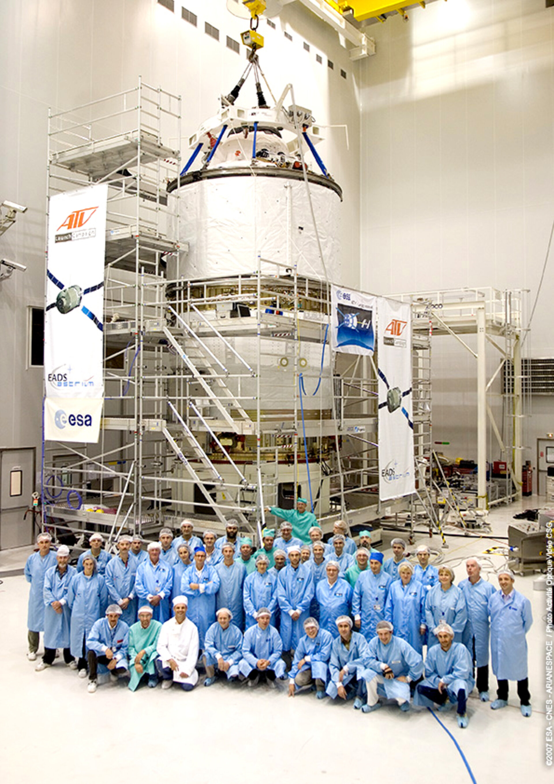 Members of the Jules Verne launch integration team in front of the spacecraft at Europe's Spaceport in Kourou, French Guiana