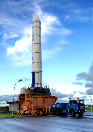 Solid rocket booster for Jules Verne's Ariane 5 ES launch vehicle is transported to the Launcher Integration Building