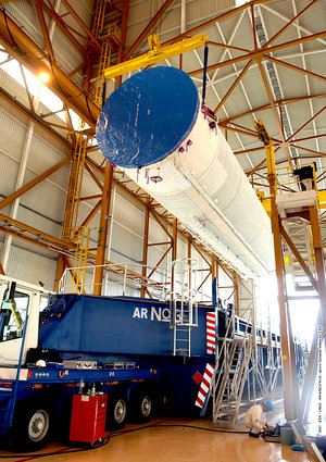 The main cryogenic stage for Jules Verne's Ariane 5 ES launch vehicle arrives in the Launcher Integration Building