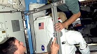 Schlegel and Walheim prepare EVA spacesuit