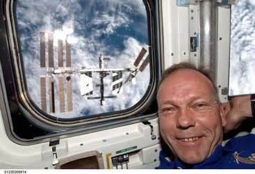 ESA astronaut Hans Schlegel in Shuttle aft flight deck shortly after Atlantis undocked from ISS