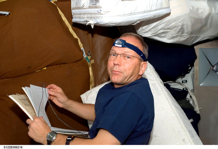 ESA astronaut Hans Schlegel works in Shuttle middeck