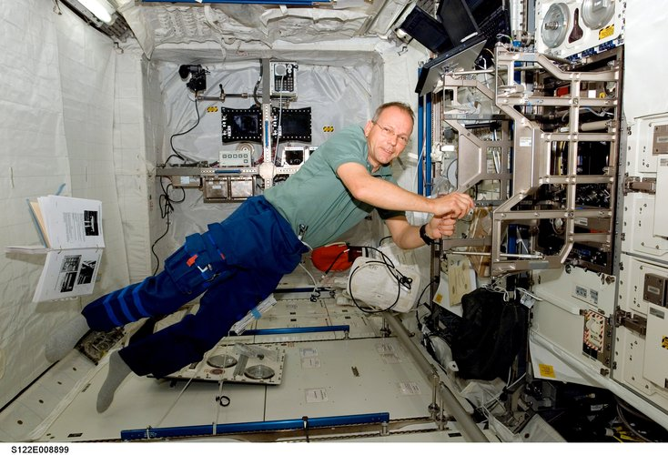 ESA astronaut Hans Schlegel works toward readying the European Columbus laboratory