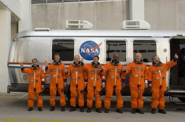 STS-122 mission crew during walk out
