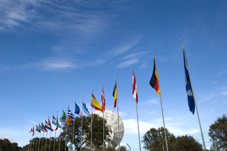 The Villafranca VIL-2 15m S-band antenna with flags of the 17 member states of ESA