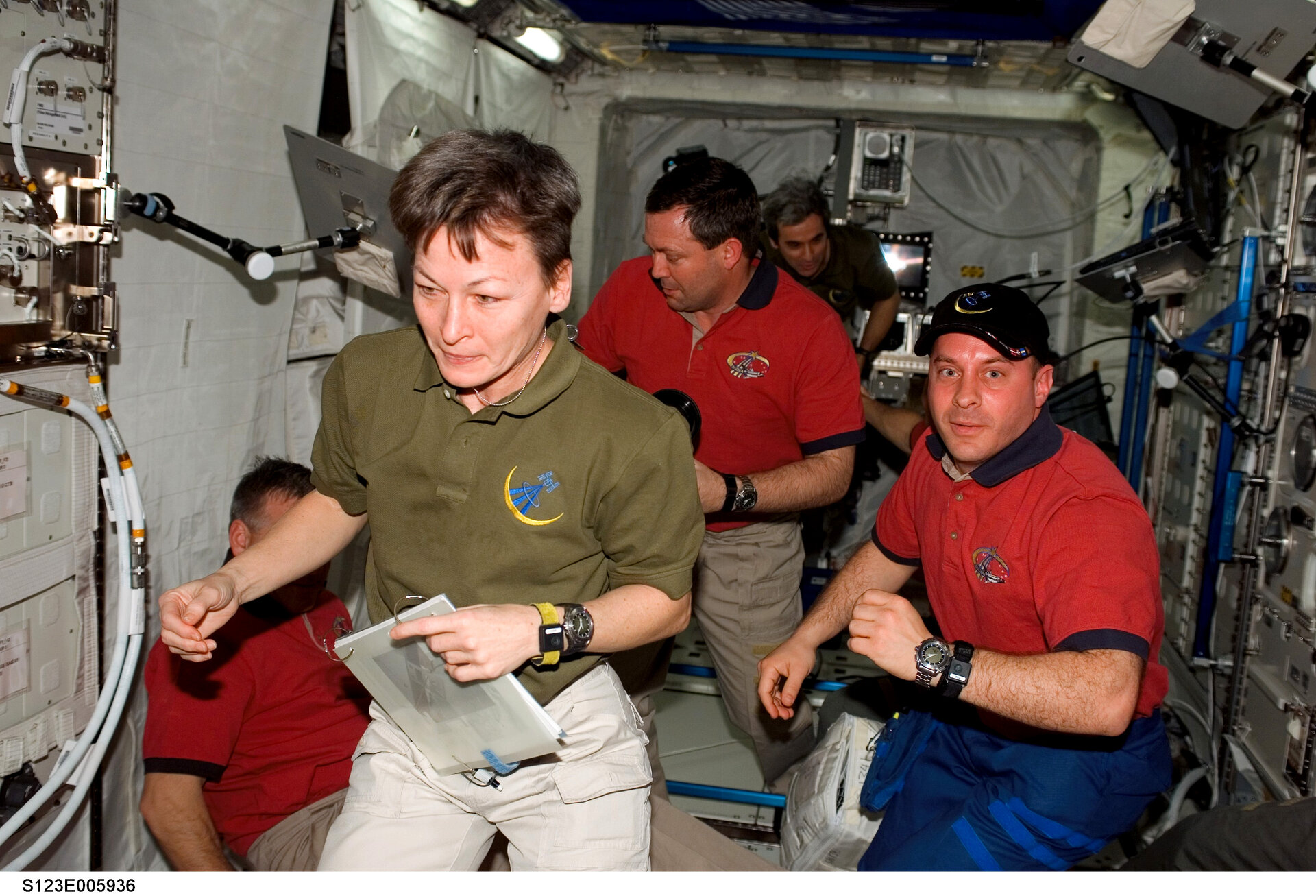 ISS and STS-123 crewmembers at work in Columbus
