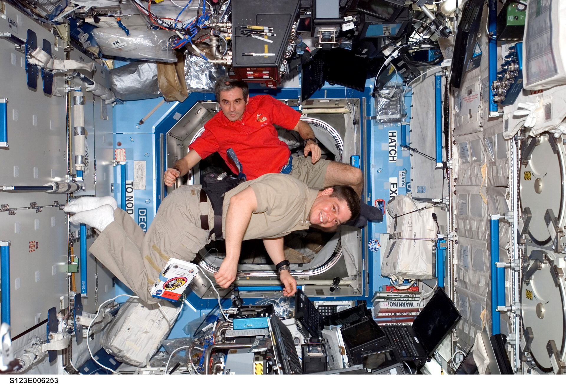 Leopold Eyharts and Bob Behnken at the controls of the ISS robotic arm