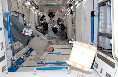Astronauts work inside the newly installed Japanese Kibo laboratory