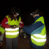 Taking soil samples at night