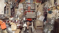 Reisman exercises on treadmill in Zvezda module
