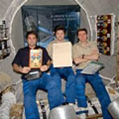 Expedition 17 with Jules Verne book and manuscripts