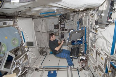 NASA astronaut Gregory Chamitoff inside Columbus