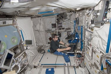 NASA astronaut Gregory Chamitoff prepares the 3D Space experiment inside Columbus