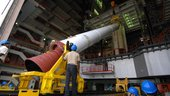 Unloading a PSLV-C11 strap-on from transporter at Vehicle Assemb