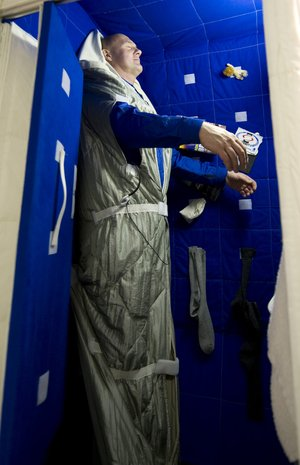 ESA astronaut Andre Kuipers tries out the Space Station bedroom mock-up at EAC